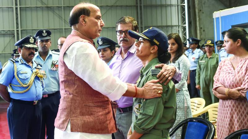 Defence minister Rajnath Singh consoles the family of a victim of the AN-32 crash after his mortal remains were brought at AFS Palam in New Delhi on Friday. (Photo: PTI)
