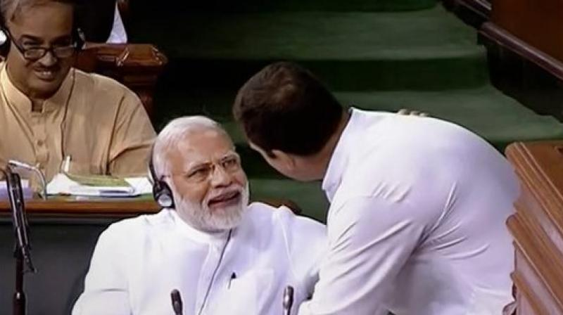 Congress President Rahul Gandhi hugs Prime Minister Narendra Modi after his speech in the Lok Sabha on 'no-confidence motion' during the Monsoon Session of Parliament, in New Delhi. (LSTV GRAB via PTI)