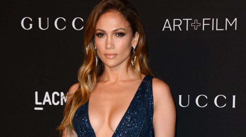 A makeup line seemed like a natural progression since people are always asking about the products I use and how I get the glow to my skin, said JLo. (Photo: AP)