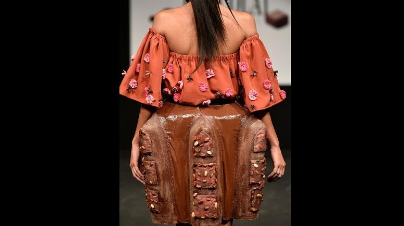 A model presents creations made with chocolate during the gala preview of the Salon du Chocolat (Chocolate Fair) in Brussels on March 01, 2018. (Photo: AFP)