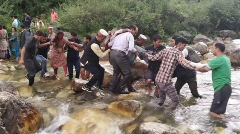 The private bus (bearing registration number HP 66-7065) fell into the over 300-metre-deep nullah near the Dhoth Morh in Banjar tehsil of the district, Kullu Superintendent of Police Shalini Agnihotri said. (Photo: ANI)