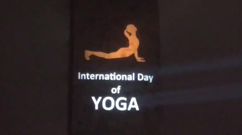 The United Nations headquarters was lit up with postures of 'Surya Namaskar' and the message of 'Yoga for Climate Action' as India's Permanent Mission to the UN kick-started its celebrations for the 5th International Day of Yoga. (Photo: Twitter)