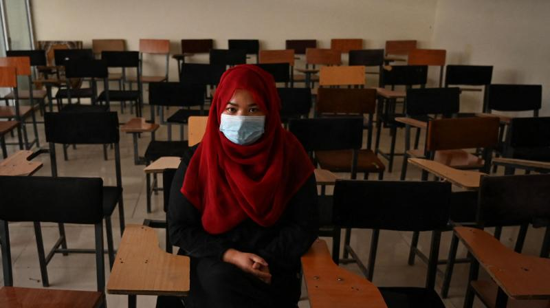 A student sits inside a classroom after private universities reopened in Kabul. (Photo: AFP)
