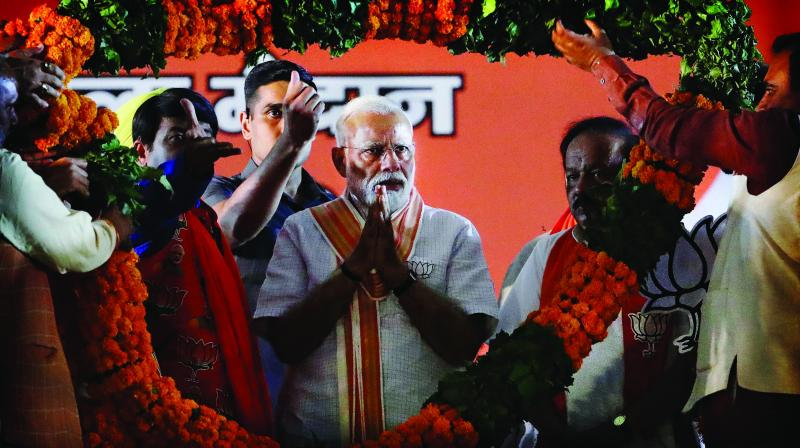 BJP leaders present a giant floral garland to Prime Minister Narendra Modi during an election campaign rally in New Delhi on May 8, 2019. (Photo: AP)