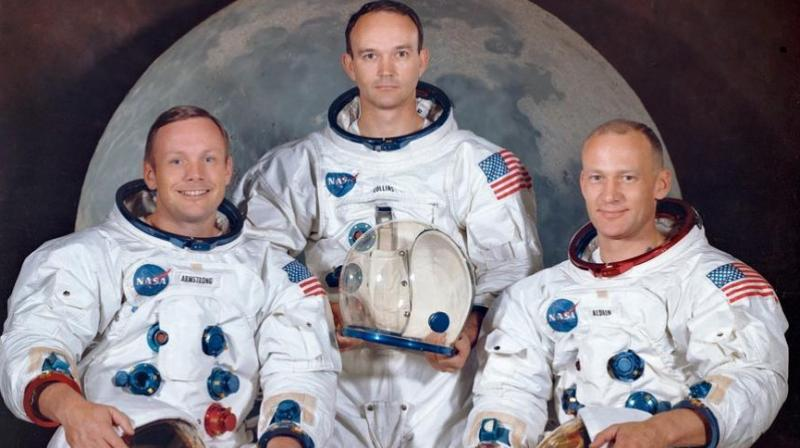 The crew of the Apollo 11, Neil Armstrong (L), commander; Michael Collins (C), module pilot; Edwin E.