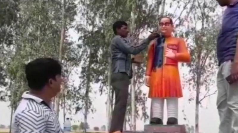 The statue, with Ambedkar wearing a saffron sherwani, triggered howls from Dalits. (Photo: ANI | Twitter)