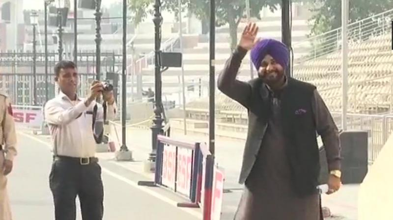 Navjot Singh Sidhu crosses the Attari-Wagah border to Pakistan to attend the ceremony of Kartarpur Corridor tomorrow. (Photo: ANI/Twitter)