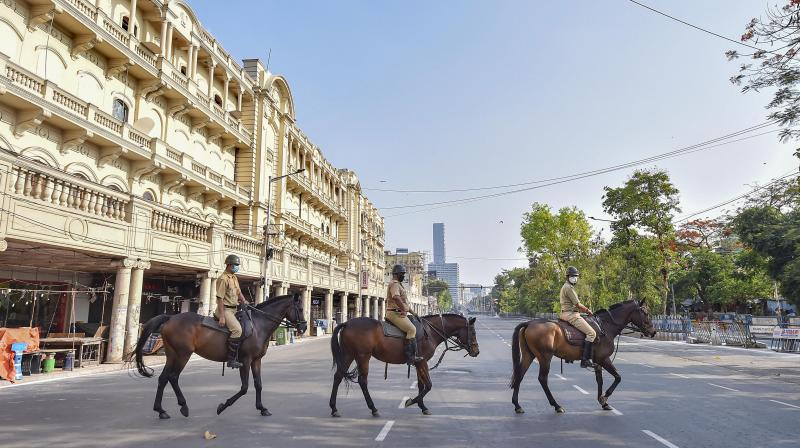 Mounted police personnel patrol a deserted road during the ongoing nationwide lockdown in Kolkata on April 14, 2020. (PTI)