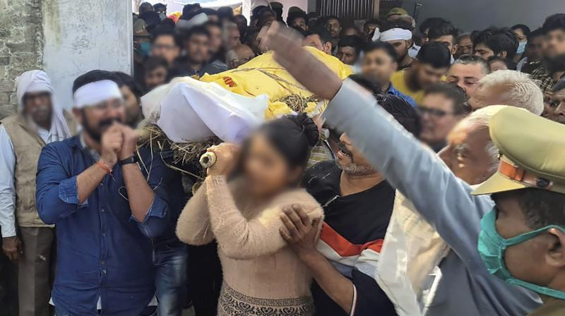 Family members carry the body of Ambrish Sharma, who was allegedly shot dead by an accused out on bail in a case of molestation lodged in 2018 against the victim's daughter, in Hathras district, Tuesday, March 02, 2021. (PTI)