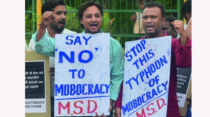 People in Ahmedabad raise slogans against the lynching of fellow citizens(Photo: PTI)