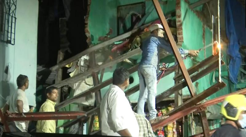 Fire fighter at the site of the collapse. (Photo: ANI)