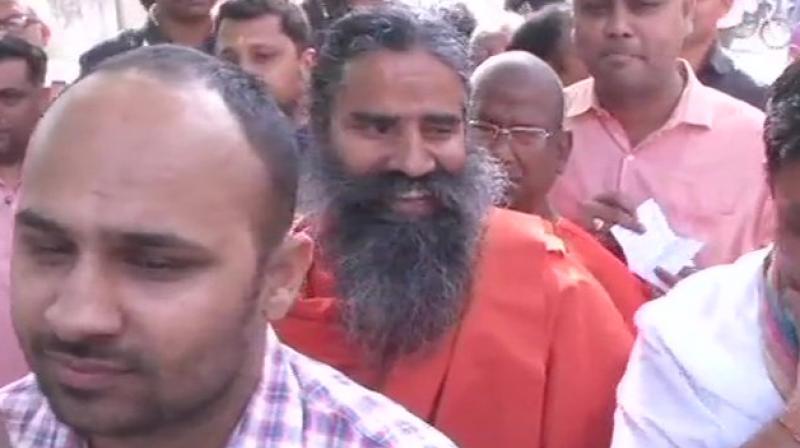 Ramdev was joined by his close associates Acharya Balkrishna and Swami Muktananda Maharaj at the polling booth. (Photo: ANI)