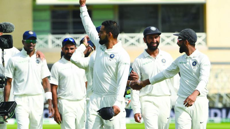 India captain Virat Kohli (foreground) waves after their win in the third Test against England at Trent Bridge in Nottingham on Wednesday. (Photo:  AFP)