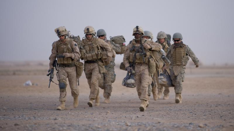 In American troops in Afghanistan. The US is keen to end its longest-ever conflict, and under the terms of a deal signed in Doha last month has said all foreign forces will quit Afghanistan within 14 months -- provided the Taliban stick to their security commitments. (AFP)
