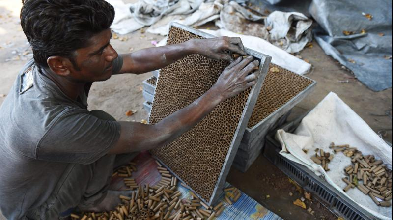 An Indian worker preparing firecrackers at a workshop on the outskirts of Ahmedabad. (AFP PHOTO)