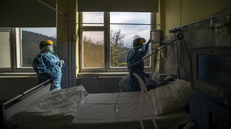 The ventilator is not therapeutic. It's a supportive measure while waiting for the patient's body to recover. In this March 24, 2020, file photo, medical staff members check a ventilator in protective suits at the care unit for the new COVID-19 infected patients inside the Koranyi National Institute of Pulmonology in Budapest. (Photo | AP)