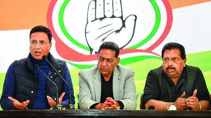 Delhi Congress chief Subhash Chopra, party spokesperson Randeep Singh Surjewala (L) and Delhi Congress in-charge P.C. Chacko at a press conference. (Photo: PTI)