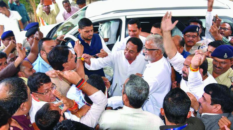 Madhya Pradesh chief minister Kamal Nath with Congress party workers during victory celebrations in Jhabua bye-elections in Bhopal on Thursday. (Photo: PTI)
