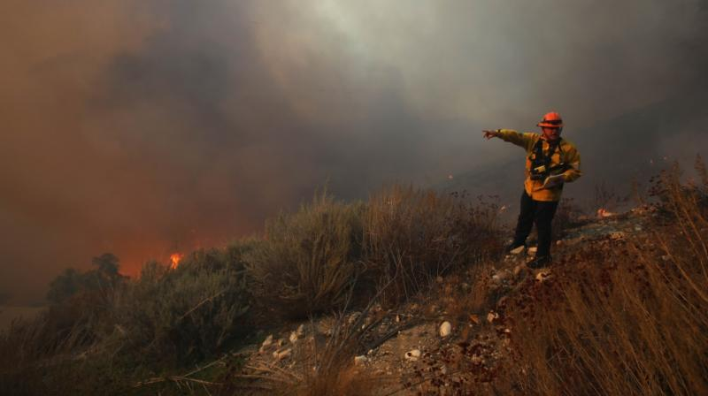 Some 50,000 residents were ordered to flee their homes north of Los Angeles on Thursday as a fast-moving wildfire driven by high winds raged out of control. (Photo: AFP)