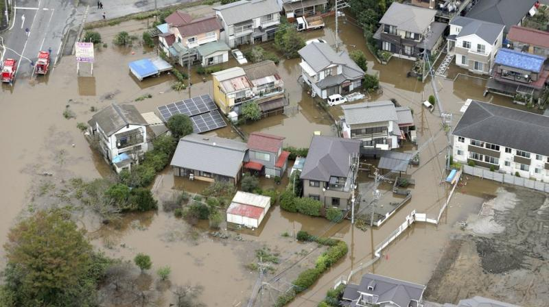 Torrential rain that caused flooding and mudslides in towns east of Tokyo left at least seven people dead and added damage in areas still recovering from recent typhoons, officials said Saturday. (Photo: AFP)