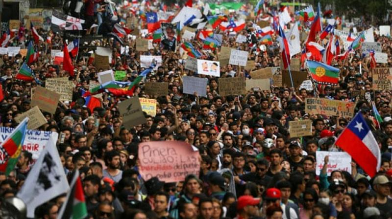 As many as a million Chileans protested on Friday in the capital Santiago in the biggest demonstrations yet since violence broke out a week ago over entrenched inequality in the South American nation. (Photo: File)