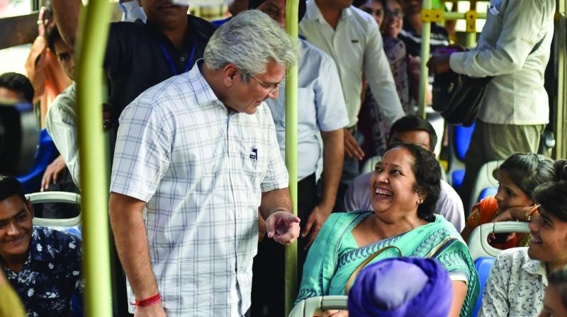 Delhi transport minister Kailash Gahlot interacts with a woman passenger inside a DTC bus at Shivaji Stadium in New Delhi on Tuesday. Women commuters. (Photo: BIPLAB BANERJEE , PTI)