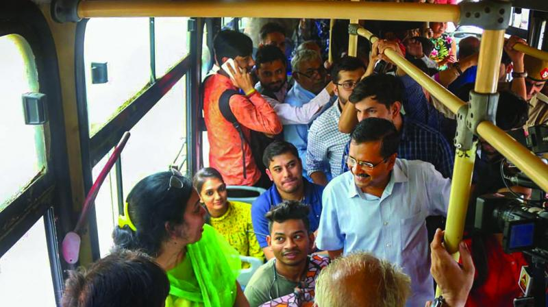 CM Arvind Kejriwal interacts with women passengers inside a DTC bus in New Delhi on Wednesday. (Photo: PTI)