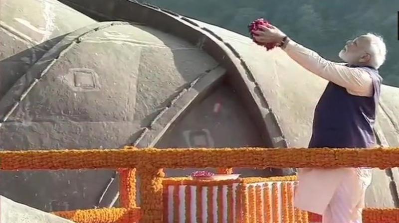 Prime Minister Narendra Modi paid floral tributes to Sardar Patel at the Statue Of Unity here on the occasion of Rashtriya Ekta Diwas on Thursday. (Photo: Twitter/ ANI)