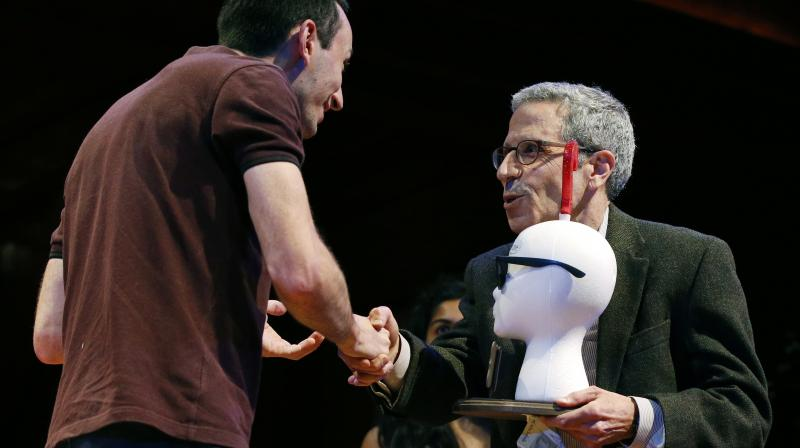 Marc-Antoine Fardin, left, accepts his Ig Nobel Physics Prize from Nobel laureate Eric Maskin during ceremonies at Harvard University in Cambridge. (Photo: AP)