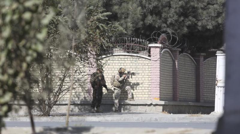 Afghan security personnel take position near the Shamshad TV station after an attack in Kabul, Afghanistan, on Tuesday. (Photo: AP)