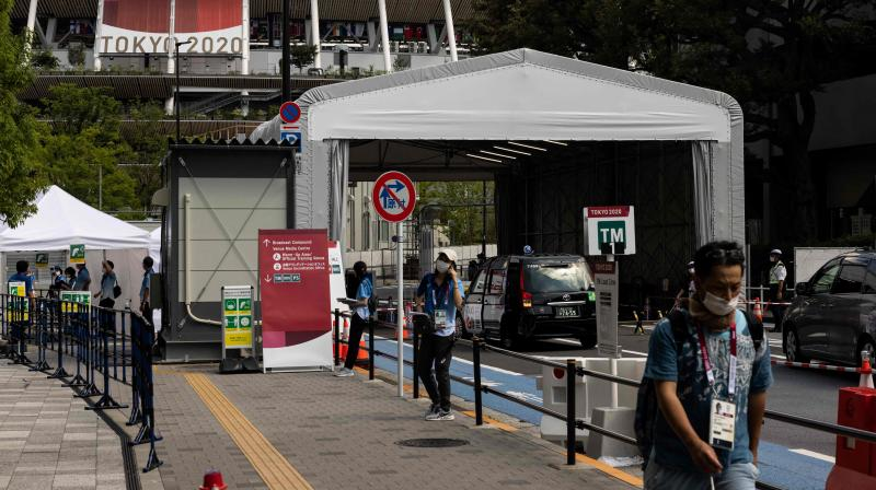 A security gate is set up near the National Stadium, the main venue for the Tokyo 2020 Olympic and Paralympic Games, in Tokyo on July 17, 2021. (Yuki IWAMURA / AFP)