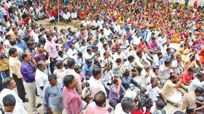 Employee unions of banks and state-run insurance companies will stage a sit-in at Azad Maidan in the city tomorrow to protest against privatisation of banks, allowing foreign direct investment (FDI) in the insurance sector and to expedite wage revision.