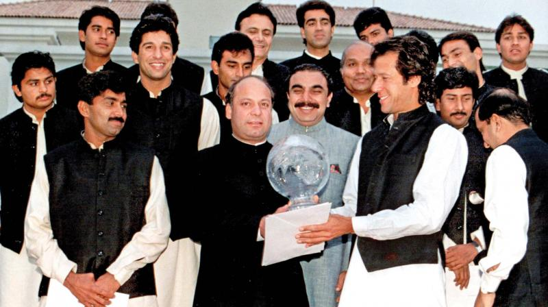 A file photo of Imran Khan offering the World Cup to the then Pakistan Prime Minister Nawaz Sharif at a dinner hosted in honour of the team after they won the 1992 World Cup. (Photo: AP)