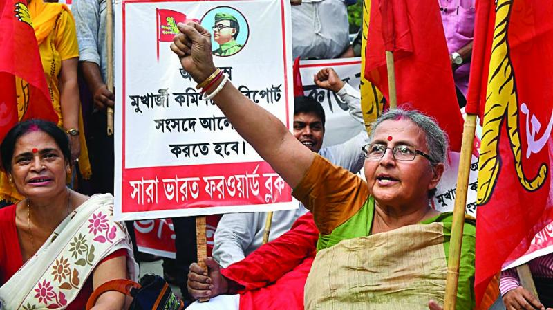 Members of All India Forward Bloc (AIFB) raise slogans during a rally on Netaji Subhas Chandra Bose death issue in Kolkata on Wednesday. (Photo: PTI)