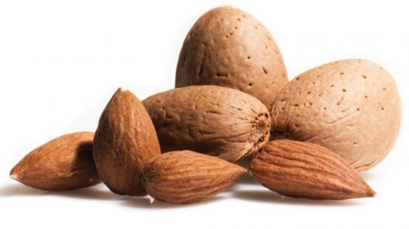 Almonds have been associated with lower blood pressure and cholesterol levels, as well as reduced hunger and weight gain. (Photo: AFP)
