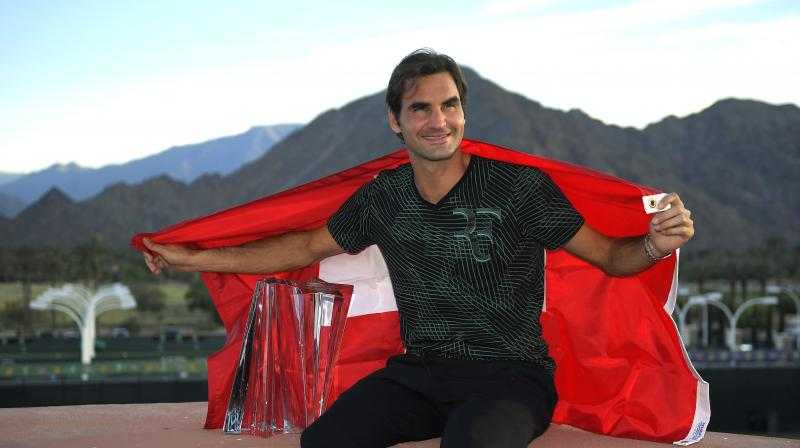 Roger Federer now joins Novak Djokovic as a five-time winner at the event and becomes the oldest champion in the tournament's history, surpassing Jimmy Connors who was 31 when he triumphed in 1984. (Photo: AP)