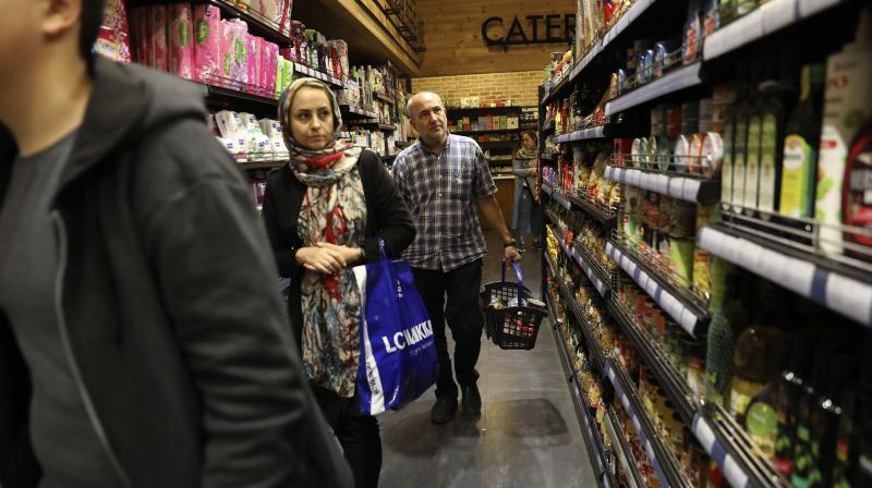 People shop at a grocery in Bamland shopping mall, in Western Tehran, Iran. AFP Photo