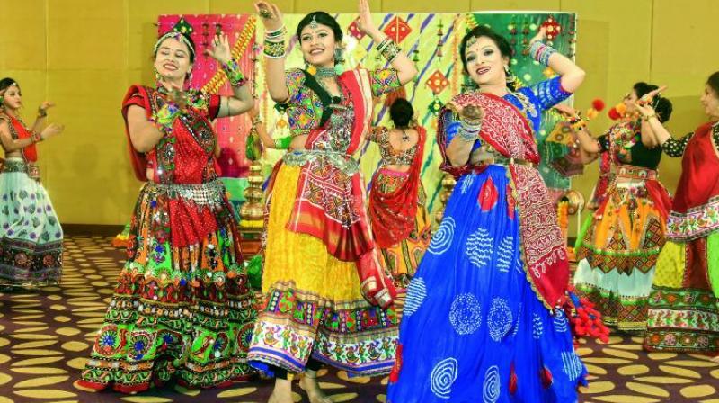 Garba choreographer Bina Mehta, along with others, dancing to the beats of garba songs.