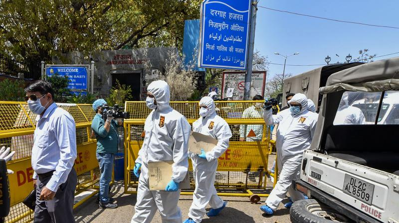 Forensics and crime branch officials arrive at Nizamuddin Markaz to conduct investigation, during the nationwide lockdown to curb the spread of coronavirus, in New Delhi. PTI photo