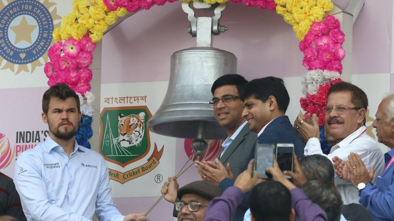 Five-time world chess champion Viswanathan Anand and current champion Magnus Carlsen on Saturday rang the bell of Eden Gardens. (Photo: Twitter/ BCCI)