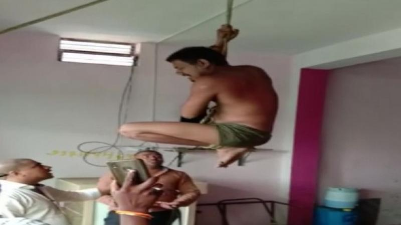 The driver, Vicky Aaglawe, a resident of Kamleshwar (Nagpur), was hung with a rope tied to the office ceiling and beaten up with belt and sticks. (Photo: ANI)