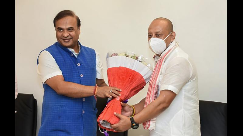 Assam Chief Minister Himanta Biswa Sarma with Sushanta Borgohain, who resigned from Congress to join BJP.  — PTI