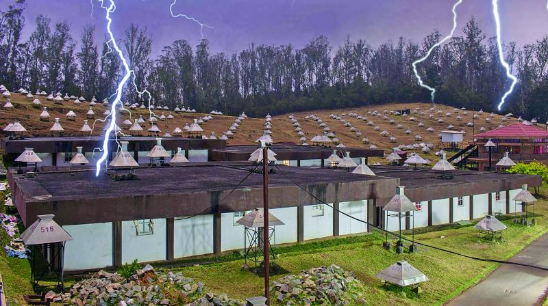 GRAPES-3 Muon Telescope at CRL in Ooty with artist's view of lightning strike.  —File photo
