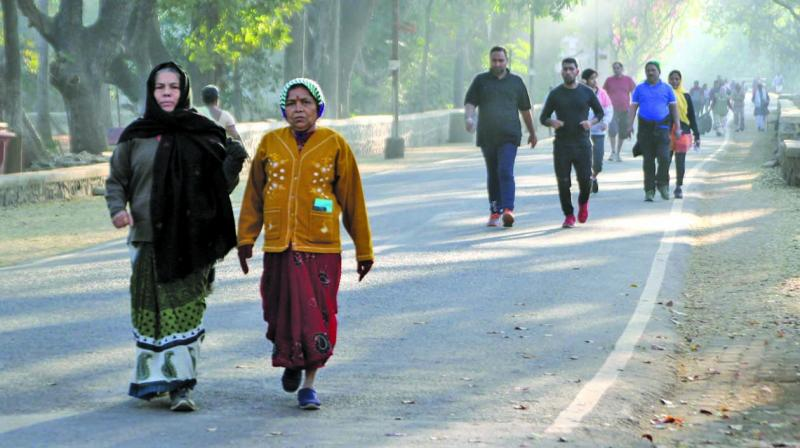 File picture of people enjoying their morning walk in winter at Aarey Colony.