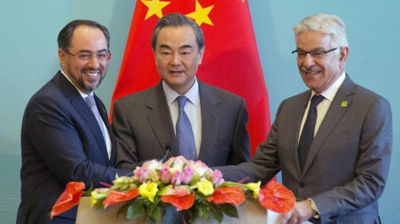 At the first trilateral meeting of foreign ministers of China, Pakistan and Afghanistan, Salahuddin Rabbani, Chinese FMWang Yi and Pakistani FMKhawaja Asif  on Tuesday, China offered to extend CPEC to Afghanistan as the three sides pledged to step-up counter terrorism cooperation. (Photo: AP)