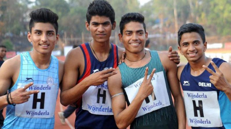 Nisar Ahmed (second from right) has been named in the 14-member contingent of budding young athletes who are selected to train for a training camp in Jamaica. (Photo: PTI)