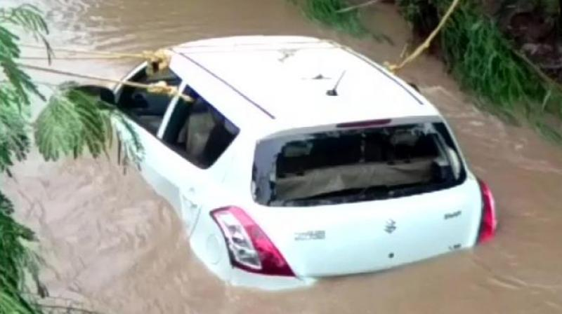 The car was found half a km away downstream. Bodies have been sent for autopsy, police said. (Photo: Twitter | ANI)