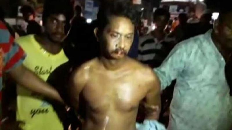 38-year-old English teacher, Rambabu, was made to walk on a busy road, in full traffic. (Photo: Twitter Screengrab/ @srinu094)