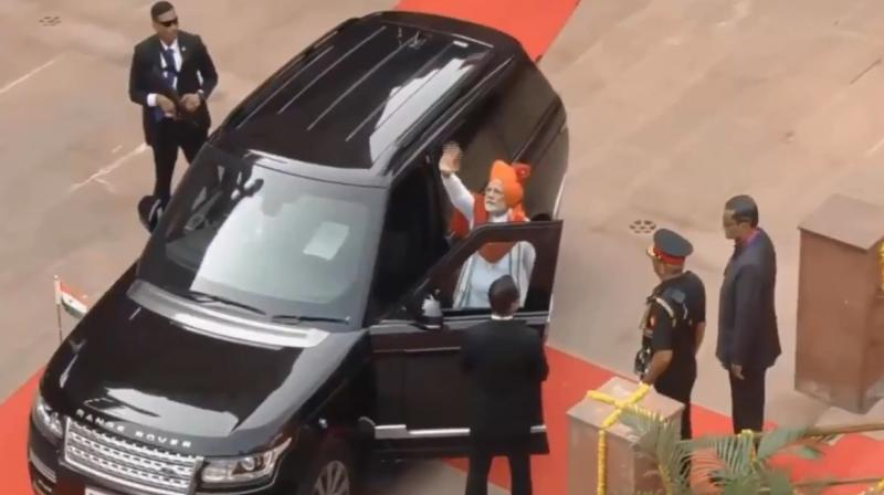In the video, Prime Minister Narendra Modi can be seen waving is hand before sitting on the navigator seat of his SUV and wearing his seat belt. (Photo: Twitter | @PIB_India)