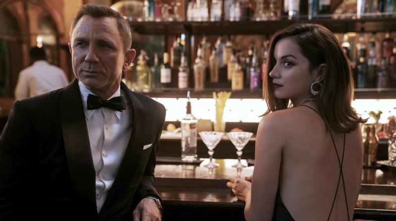 This image released by Metro Goldwyn Mayer Pictures shows Daniel Craig, left, Ana de Armas in a scene from